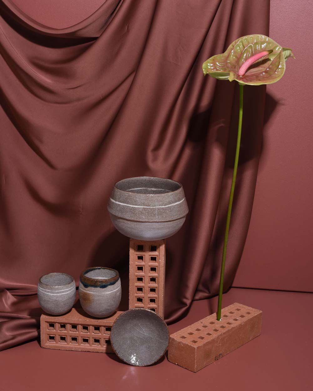 Styled image of Irene & Edith ceramics on terracotta bricks