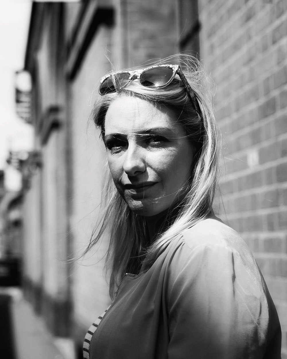Portrait of Kate Baxter, founder & editor of Fabric of the North
